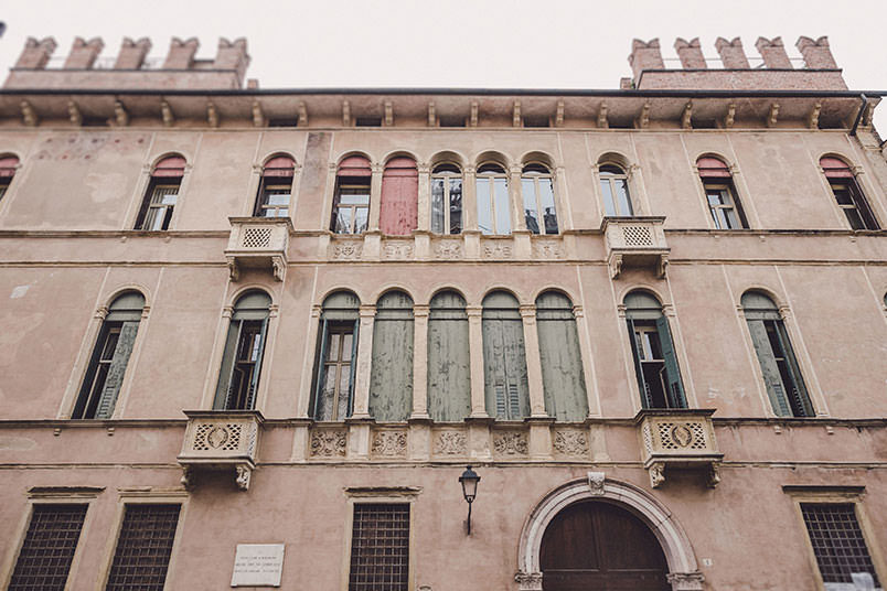 A modern vintage wedding: ancient typical venetian building in front of the church