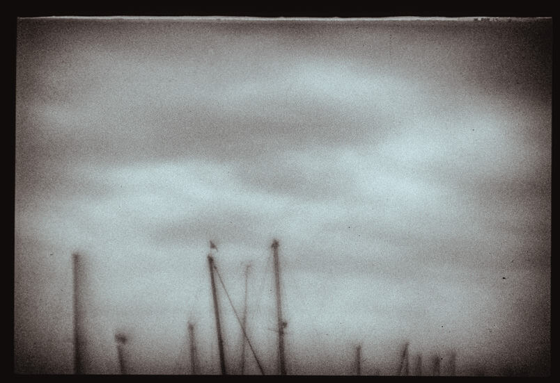 Analogue fine art photography in Venice. Polaroid Polapan film. Boats at San Giorgio island.