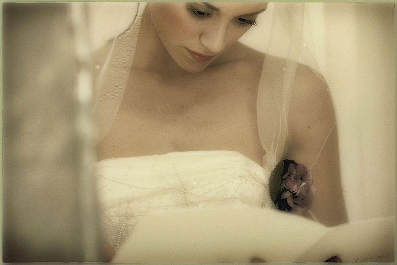 Fairy Tale Wedding Style: the bride looking at her mise en place.