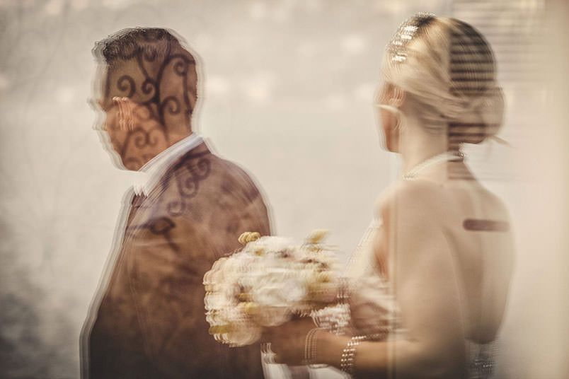 Wedding photographer: a double exposure of the bride and groom.