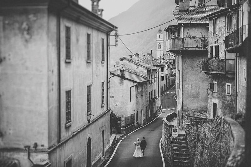 Wedding shooting on Lake Como, Italy. The bride and groom walking in an old village.