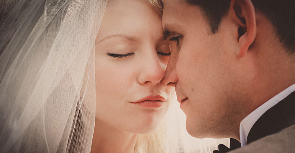 Bride and groom before a kiss
