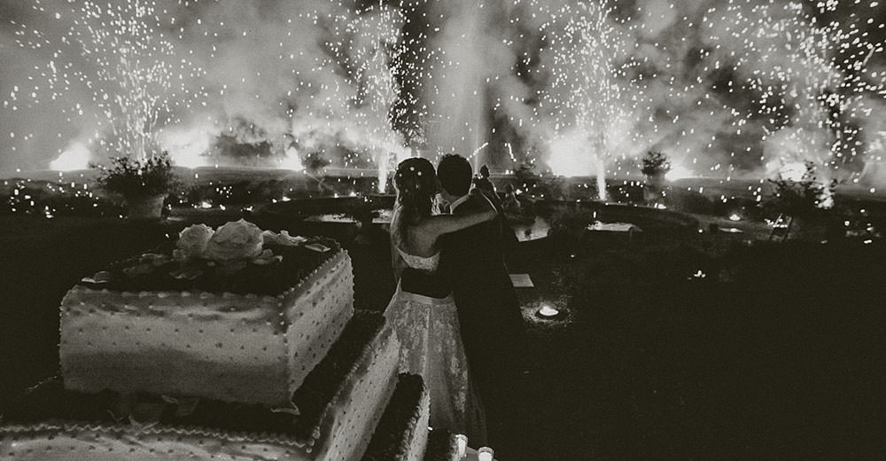 Wedding: the bride and groom looking at their fireworks