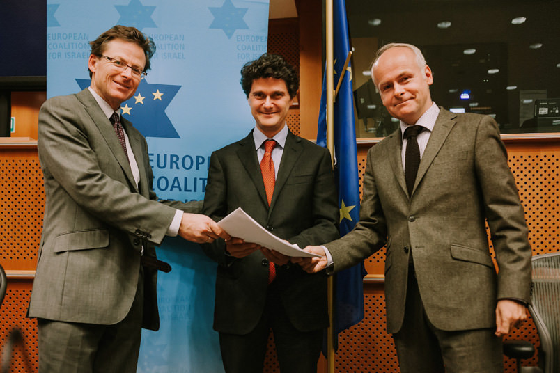 Tomas Sandell and Andrew Tucker handing over open letter regarding the EU guidelines to Deputy Head of Division Jerome Cassiers from the European External Action Service, representing the High Representative Baroness Ashton