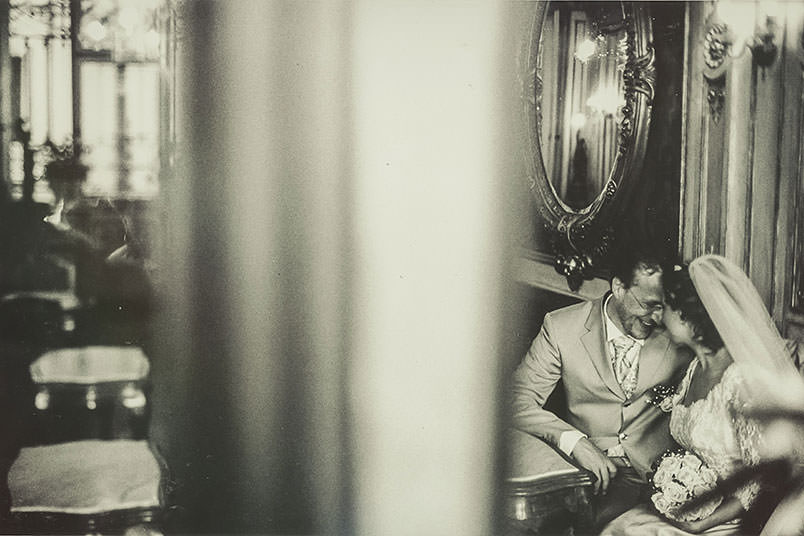 Venice: unconventional wedding photography. The couple inside the Caffè Florian.
