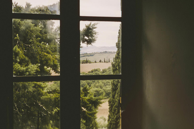 Wedding in Tuscany: typical italian landscape from a window.