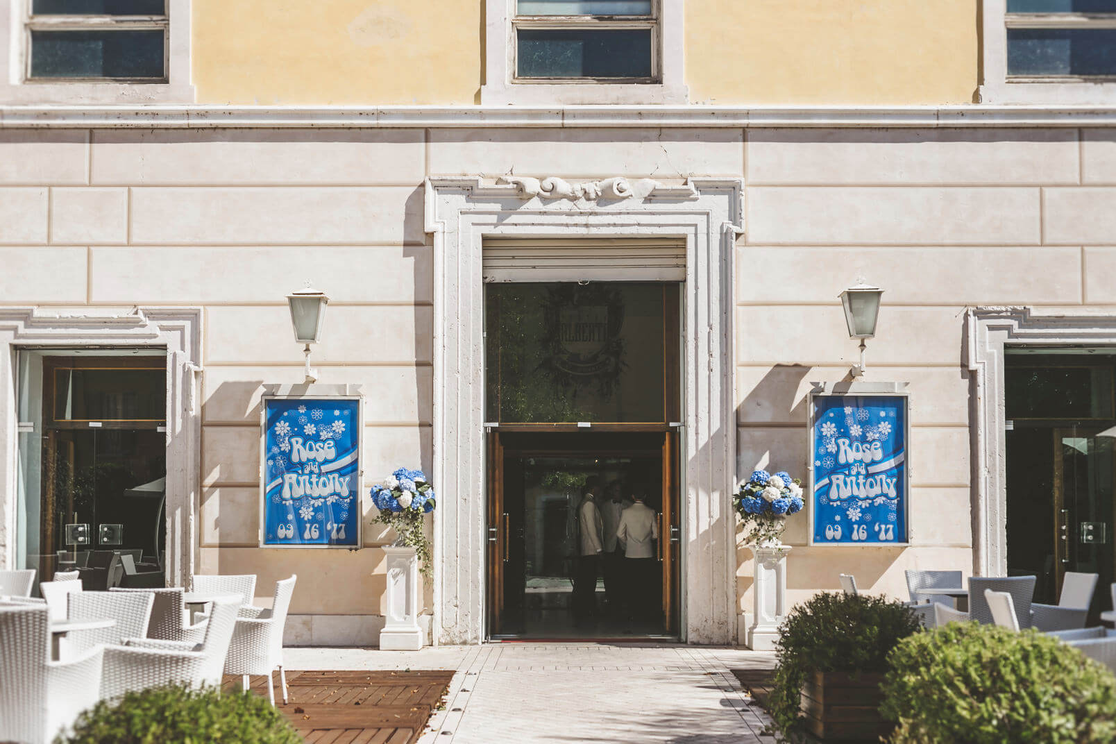 Teatro Alberti, Desenzano del Garda. The main facade of the wedding venue with the bills related to the wedding.