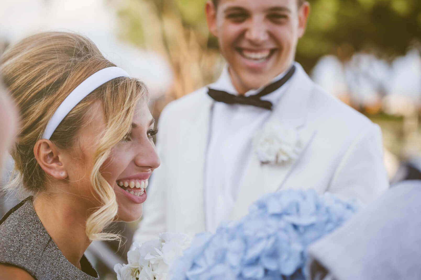 The bride and groom smiling, candid scene.