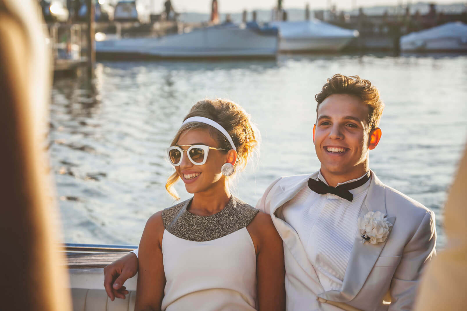 Candid portrait of the newlyweds on the taxi boat.