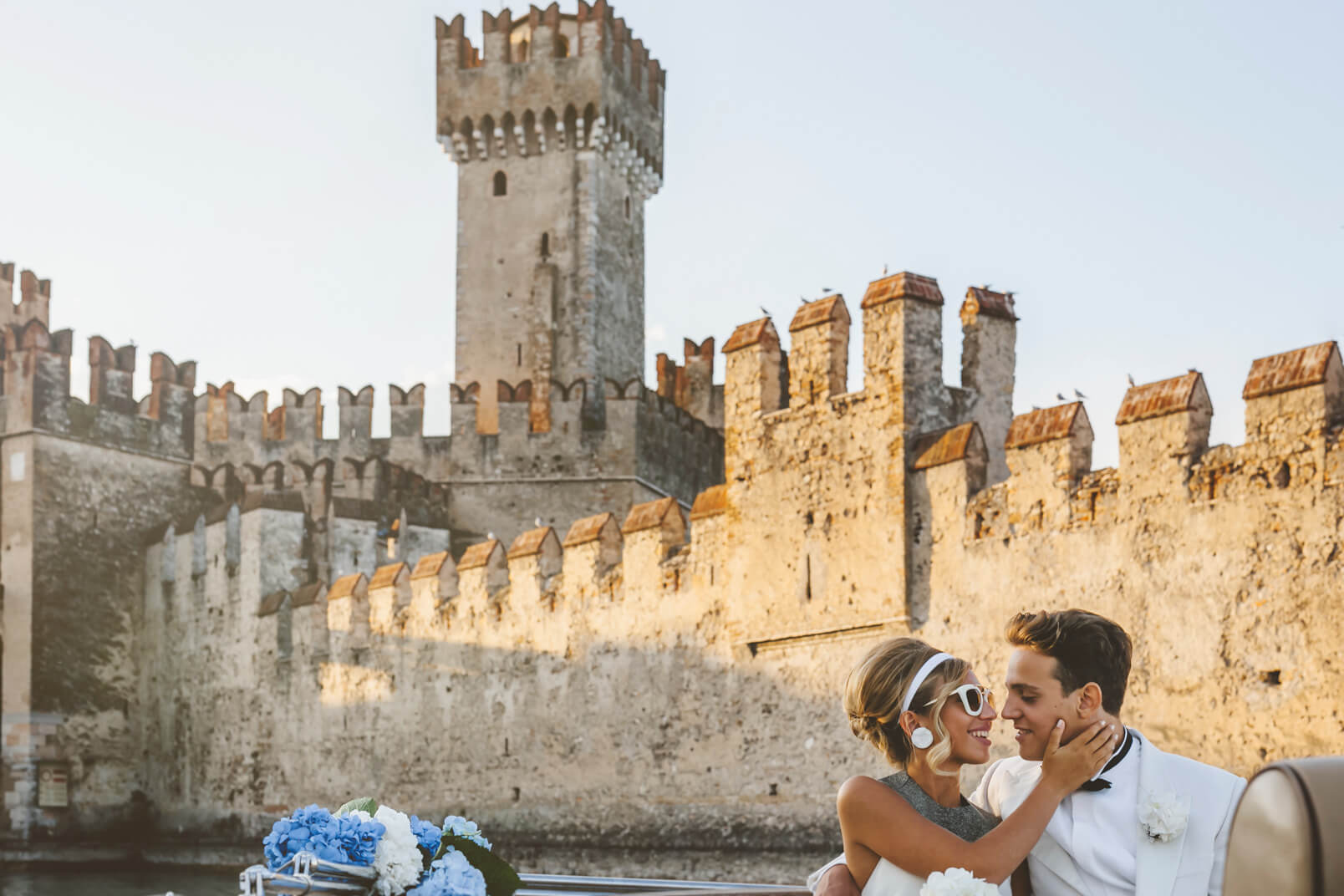 A Kiss with the Sirmione castle in the background.