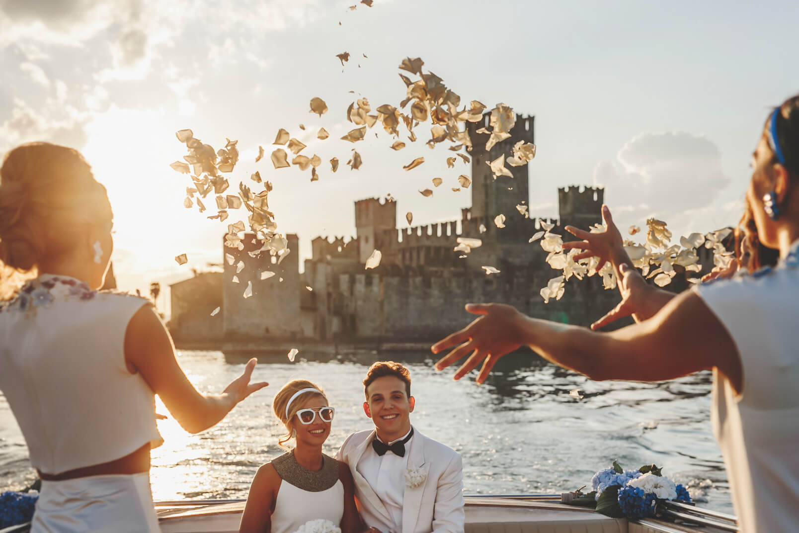 Topic is: petal tossing ideas! On the taxi boat, the bridesmaids throwing petals.
